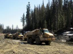 Rock trucks hauling armor rock down to the creek Apr 2015