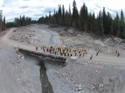 Likely community site tour June 12, 2015 - group stands on Gavin Lake Road bridge to view the channel reconstruction and erosion control work progress.